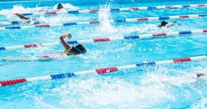 42556877 - kids swim meet in outdoor pool during the summer.
